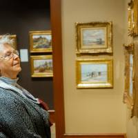Guest admiring paintings at Friends of Alten 2018